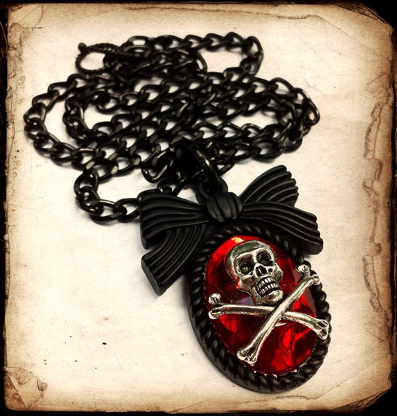 Black Skeleton Bow Necklace with Red Stone
