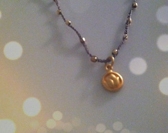 Gold Lotus Necklace on a Beaded Crochet Chain