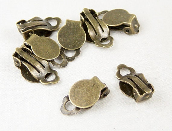 Earring Findings 8 Earring Clip-on Antique Bronze Non-Pierced (4 pairs) 18mm long, Pad 10mm NF (1034ear18z1) ... last remaining packages
