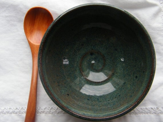 Blue baby food bowl with double ridge detail and wooden spoon