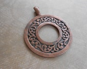 Metal Pendant Antiqued Copper Round Scrollwork