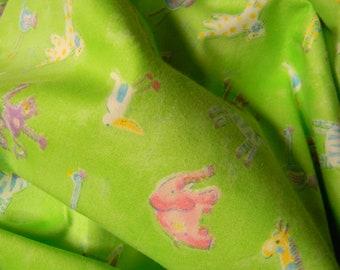 Safari Kids with Monkeys, Elephants, Giraffes, Zebras and Other Animals on Green Cotton Fabric