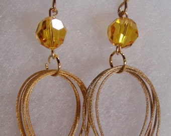 Multihoop gold earrings with light topaz or siam Swarovski crystals