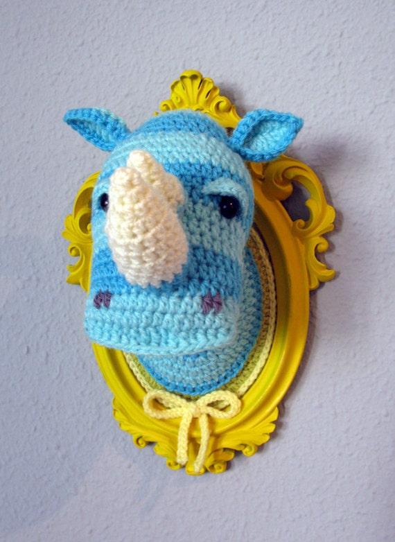 Crochet blue rhino head in a yellow frame