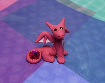 Handmade Polymer clay Magenta mini dragon figurine holding red Swarovski crystal with heart tattoo