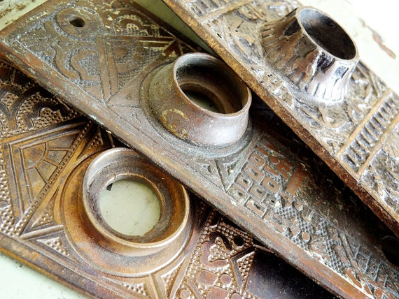 vintage brass door plate or escutcheon, art deco style, brass with patina (2)