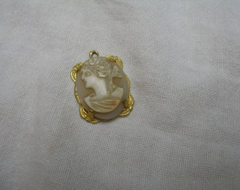 Shell Cameo pendant set in gold plated metal, ca1920s