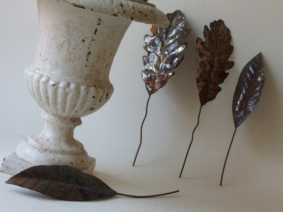 four vintage rusty tin leaves