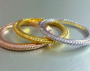 Gold stacking rings. 14k gold.  textured bands.