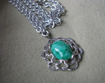 Silver tone link vintage necklace with green marbled pendant.  FLATTERY by Sarah Coventry
