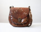 1960's tooled leather messenger bag