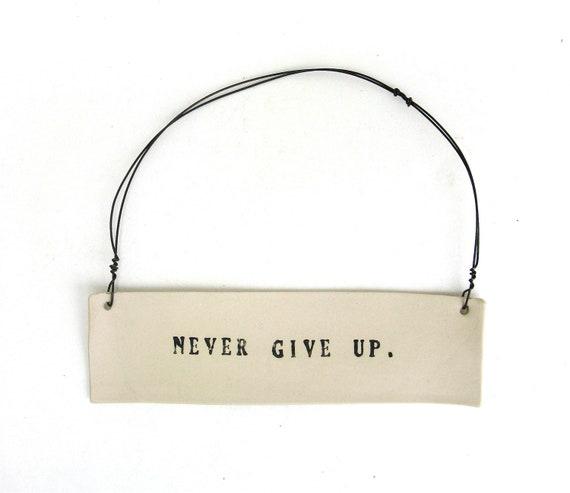 never give up   ...   inspiring tag   ...   hanging porcelain sign