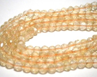 Citrine faceted round beads half strand