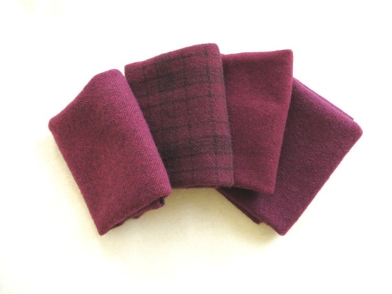"""Hand dyed felted wool in a combination of four fat eigths in complimentary wine tones measuring 15"""" x 13"""""""