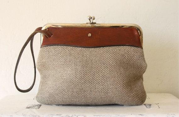 etienne aignier woven wristlet bag . leather & linen
