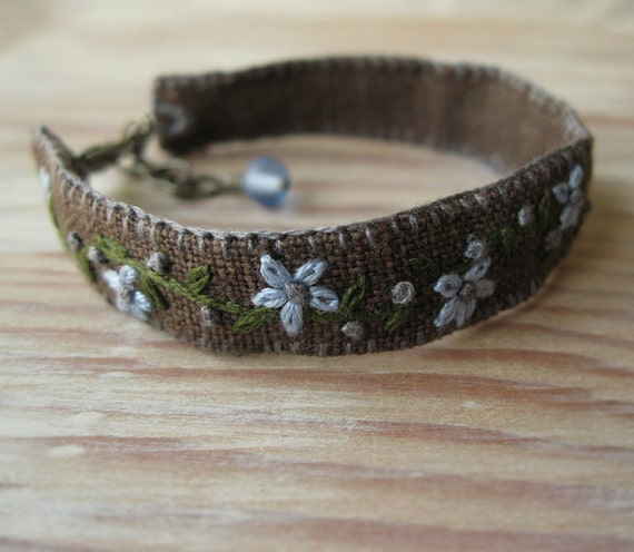 Fiber Bracelet Embroidered with Blue Flowers on Brown Linen