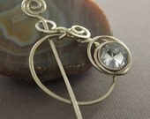 Penannular German silver shawl pin or scarf pin with a wrapped clear crystal like button