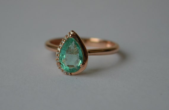 Rose Gold Halo Ring with Light Colored Colombian Emerald and Diamonds