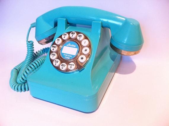 Vintage blue turquoise teal aqua push button phone.  Retro telephone.