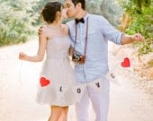 LOVE photo prop with red hearts