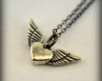 Two for One Sale....Silver Flying Heart Necklace