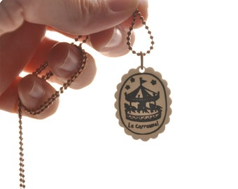 Carrousel shrink plastic necklace