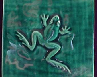 Decorative, relief carved ceramic frog tile