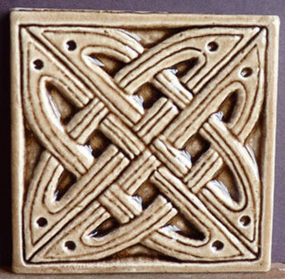 Decorative relief carved ceramic celtic knot tile