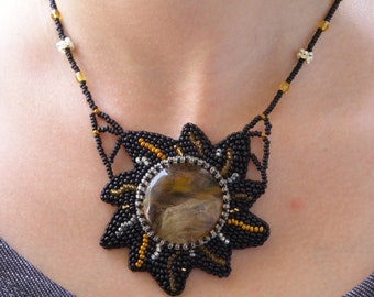 Black and gold embroidered pendant with cherry quartz gem stone OOAK