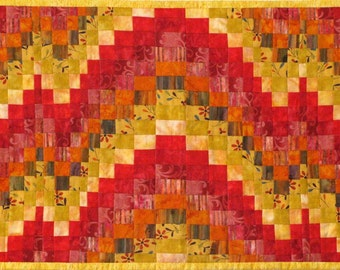 Bargello Quilted Coffee Table Runner in Reds and Yellows