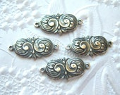 Antique silver swirl connector, lot of (4) - GB136