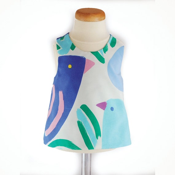 ON SALE Was 40 now 20 Ken Done fabric baby pinafore 0 - 6 months with blue bird
