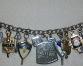 Funky Found Object Charm Bracelet With High School and College Crests