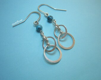 Interlocked loops with turquoise stone bead sterling silver earrings