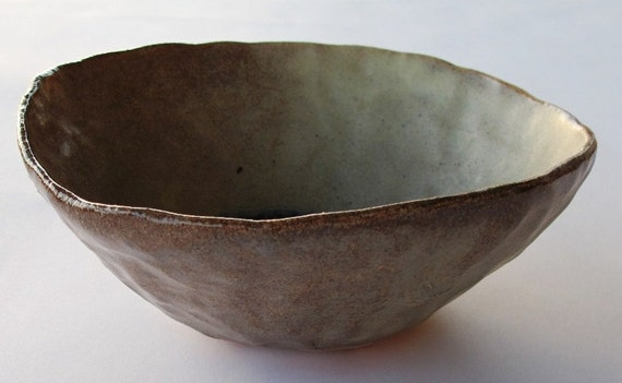 Ceramic bowl beige and blue colored glass inside