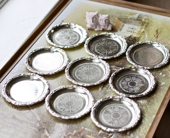 vintage silver plated coasters set of 9