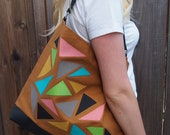 Triangle hobo bag in Tan.