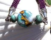 Original and Unique Purple Wire Bracelet Viking Knit with Glass Lampwork Bead