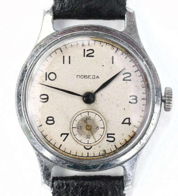 A RARE soviet Russian mens wristwatch Pobeda from Soviet Union era shabby chic style watch