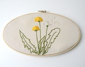 Embroidered dandelions on cream cotton wood embroidery oval hoop