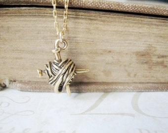PURL knitting needles and yarn charm necklace (available in gold or silver)