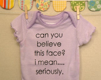 can you believe this face --- purple striped snapsuit, size newborn