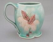 Aqua round mug with pink flower