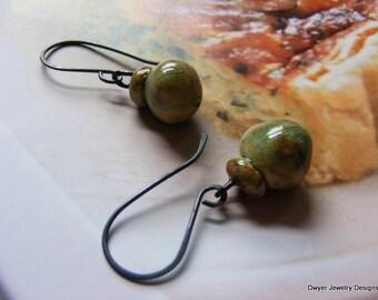 Porcelain Bobble Earrings in an oxidized silver setting.