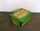 Vintage emerald green box of staples for decoration or office supply