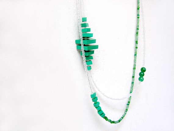 double strand geometric architectural necklace with green polygons