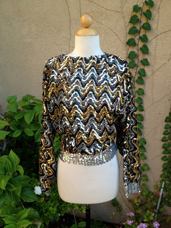A vintage 1970s 1980 black silver and gold sequined dolman sleeves disco hippie party shirt top size M L