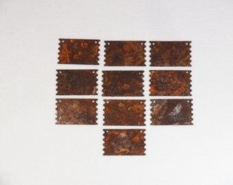 """25 Rusty Tin Signs 1"""" W x 11/16"""" H"""