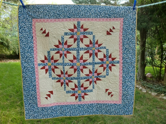 Mexican Star Quilt in Red, Blue and Tan.