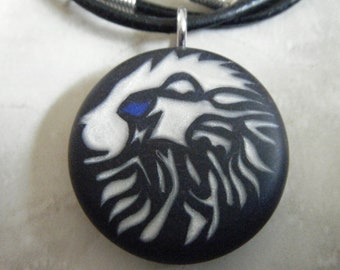 Zodiac LEO hand carved on a polymer clay midnight blue color background. Pendant comes with a FREE 3mm necklace.